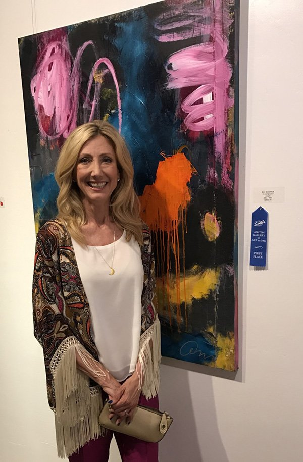 Ann Golumbuk in front of her painting at the Ashton Gallery's Anniversary Art Show